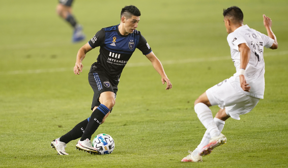 Cristian Espinoza of the San Jose Earthquakes with possession vs. the LA Galaxy
