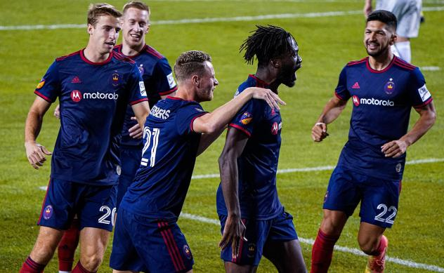 Chicago Fire FC forward CJ Sapong receives congratulations after his goal