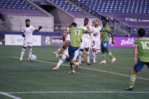 Seattle Sounders FC battle the Portland Timbers