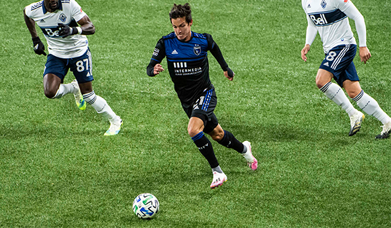 The San Jose Earthquakes' lone goal-scorer of the match, Carlos Fierro, dribbles near a pair of Whitecaps FC defenders