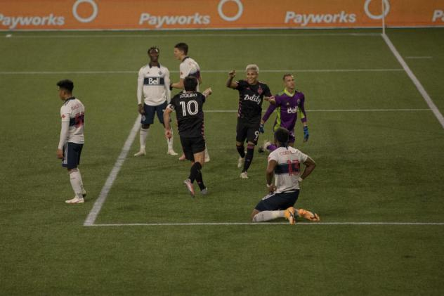 Seattle Sounders FC celebrate a goal against the Vancouver Whitecaps