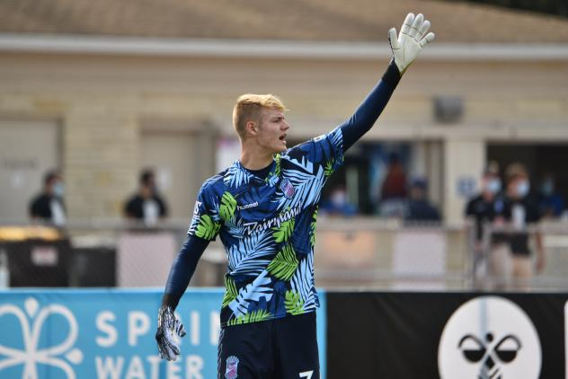 Forward Madison FC goalkeeper Chris Brady