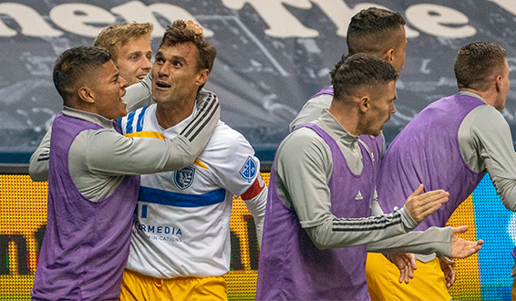 Chris Wondolowski of the San Jose Earthquakes celebrates his goal in the 97th minute to force overtime