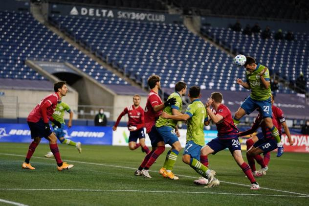Seattle Sounders FC go high for a header against FC Dallas