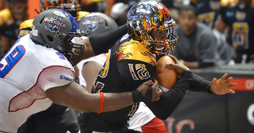Defensive lineman Harold Love (left) with the Portland Thunder