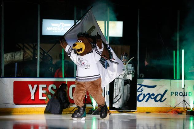 Utah Grizzlies mascot Grizzbee leads the team on to the ice