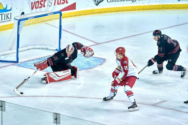 Corey Mackin of the Allen Americans (center) vs. the Rapid City Rush