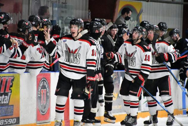 Aberdeen Wings exchange congratulations along the bench