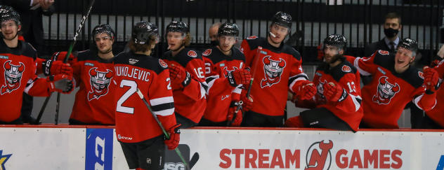 Michael Vukojevic and the Binghamton Devils bench