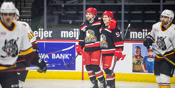 Grand Rapids Griffins pose after a goal against the Chicago Wolves