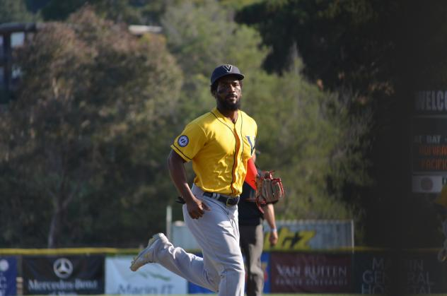 Nick Akins of the Vallejo Admirals takes a glance at the camera on his way back to the dugout