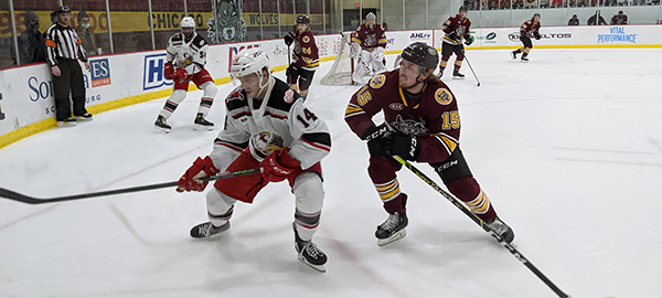 Grand Rapids Griffins right wing Jarid Lukosevicius (left) vs. the Chicago Wolves