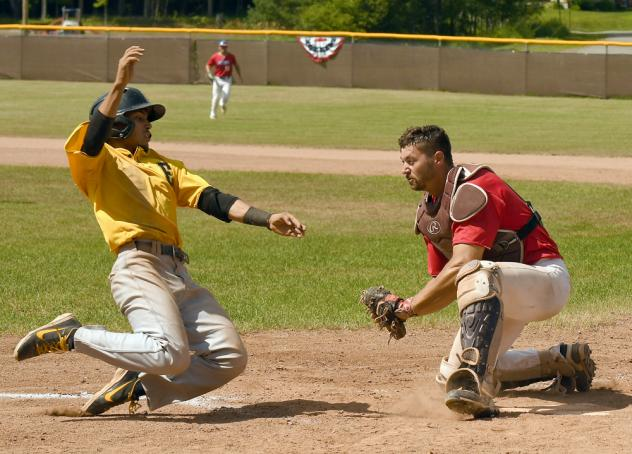 Catcher Tyler Hill prepares to make a tag
