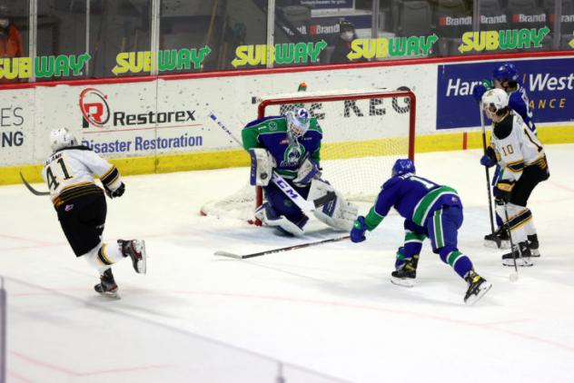 Brandon Wheat Kings defenceman Neithan Salame (left) takes a shot against the Swift Current Broncos
