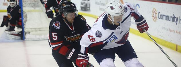 South Carolina Stingrays forward Mark Cooper (right) vs. the Indy Fuel