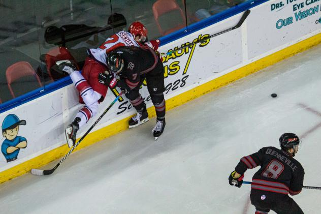 Spencer Asuchak gets checked into the boards against the Rapid City Rush