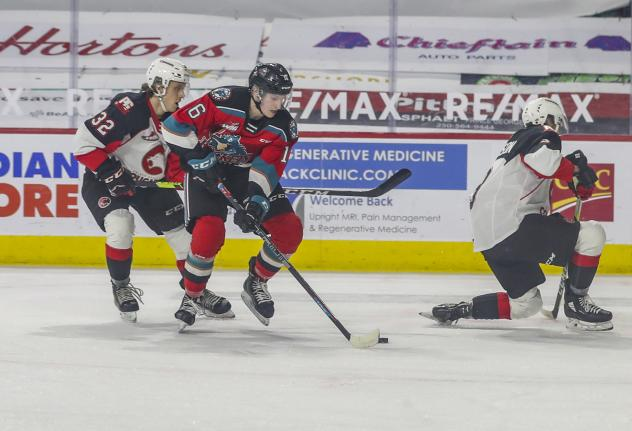 Kelowna Rockets centre Scott Cousins handles the puck against the Prince George Cougars
