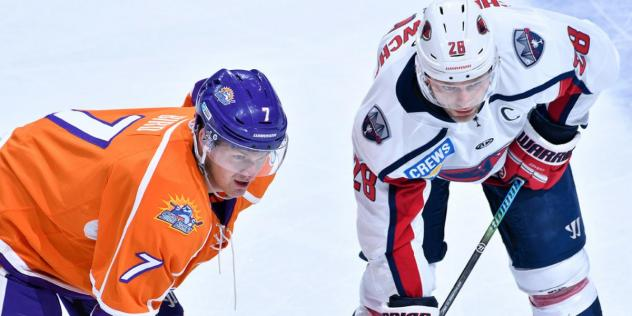 Orlando Solar Bears forward Tyler Bird (left) faces off with the South Carolina Stingrays