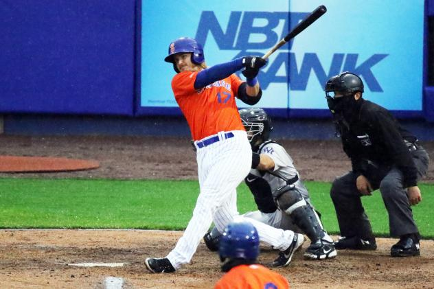 Martin Cervenka of the Syracuse Mets follows through during his home-run swing in the bottom of the second inning