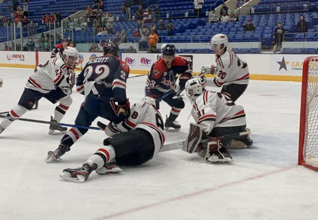 Odessa Jackalopes and Amarillo Bulls scramble in front of the Odessa net