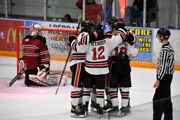 Aberdeen Wings celebrate one of 10 goals vs. the Minot Minotauros