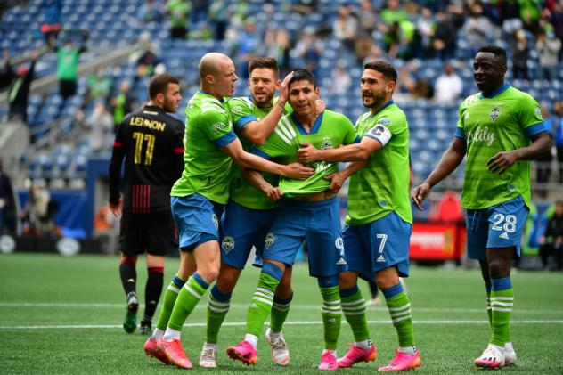 Seattle Sounders FC forward Raúl Ruidíaz receives congratulations from his teammate
