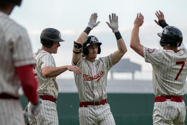 Kansas City Monarchs Ryan Grotjohn celebrates after one of his two home runs with teammates Casey Gillaspie and #7 Colin Willis
