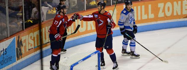 South Carolina Stingrays exchange a fist bump after a score against the Jacksonville Icemen