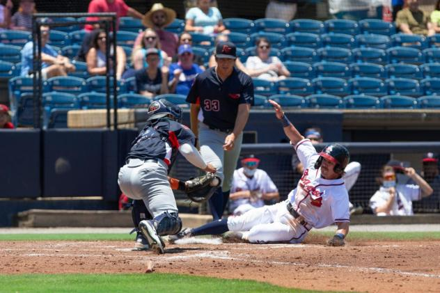 Rome Braves slide home for a run against the Bowling Green Hot Rods