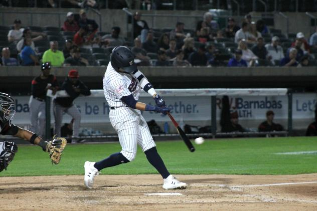 Oswaldo Cabrera makes contact for the Somerset Patriots