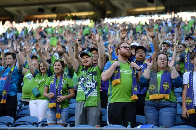 Seattle Sounders FC fans cheer on their team
