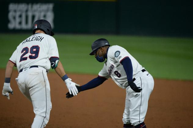 Cal Raleigh of the Tacoma Rainiers receives congratulations while circling the bases