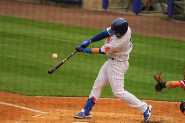 The Syracuse Mets' Chance Sisco connects with a ball that he hit for a three-run home run in the first inning on Friday night