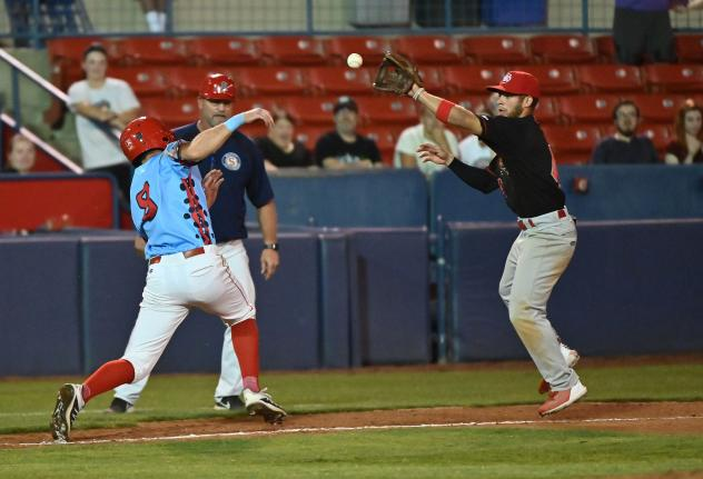 Spokane Indians scramble to base against the Vancouver Canadians