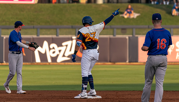 Romer Cuardrado of the Tulsa Drillers stands at second base after one of his two doubles in Friday's game