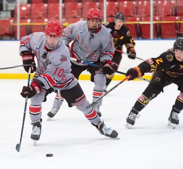New Jersey Titans forward Tommy Bannister handles the puck