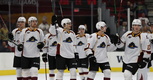 Cleveland Monsters salute the fans during a game against the Syracuse Crunch