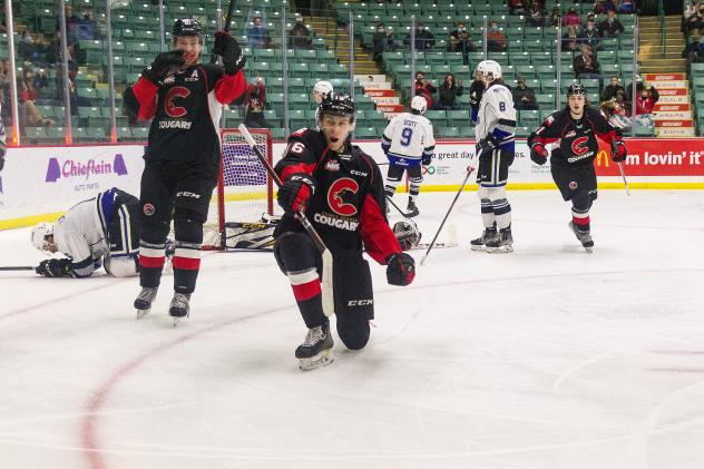Prince George Cougars left wing Carter MacAdams celebrates a score against the Victoria Royals