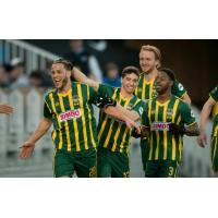 Rochester Rhinos Tony Walls (No. 20) Celebrates with Rochester Teammates