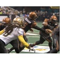 Arizona Rattlers Quarterback BJ Coleman Hands off the Ball vs. the Las Vegas Outlaws
