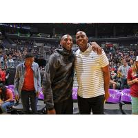 Kobe Bryant and Ervin 'Magic' Johnson at the Los Angeles Sparks Home Opener