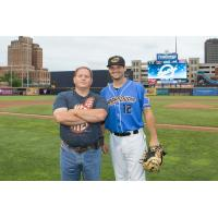 Christopher Lee of C. Lee Services with Akron RubberDucks' Jeremy Lucas