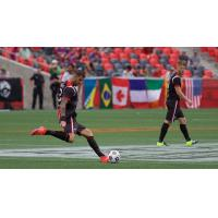Rafael Alves, kicking, and Richie Ryan of Ottawa Fury FC