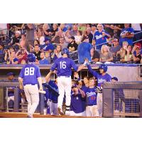 Lars Anderson of the Tulsa Drillers Congratulated in the Dugout