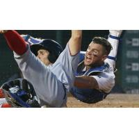 Buffalo Bisons Catcher Sean Ochinko's Attempts to Tag out Ricky Hague of the Syracuse Chiefs