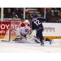 Jordan Topping of the Tri-City Americans Shoots on the Spokane Chiefs