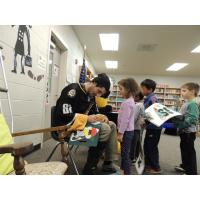 Mississippi RiverKings Defenseman Tim Boyle Signs Autographs for Bailey Station Elementary Students