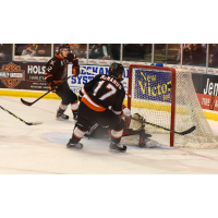 Omaha Lancers Pressure the Chicago Steel Goaltender