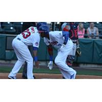 Domonic Brown of the Buffalo Bisons Congratulated by Dalton Pompey