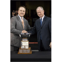 Brent Thiessen of the Missouri Mavericks (left) Accepts the Brabham Cup from ECHL Commissioner Brian McKenna